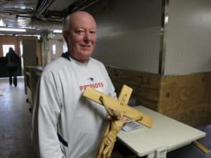 Mike White, a material management consultant on the decommissioning of the old St. Joseph Hospital, holds one of the more that 450 crosses being donated.