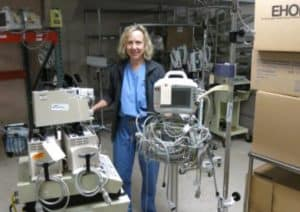 Dr. Peggy Schrieber is preparing gear to be shipped to a town in Zambia where there is no running water, no indoor plumbing, and no electricity.