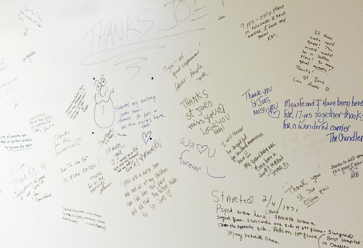 Employees cover the walls with farewell messages before leaving.